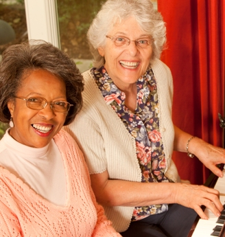 Two Women Playing Piano
